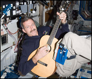 NASA astronaut Dan Burbank plays guitar on ISS